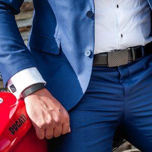 Man with suit wearing carbon fiber belt, cufflinks and bracelet