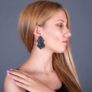 Girl with Carbon_Fiber_ Earrings_Diamonds