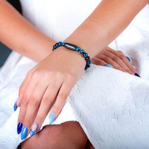 Girl`s hand with Carbon fiber Bracelet Tiger`s Eye Blue