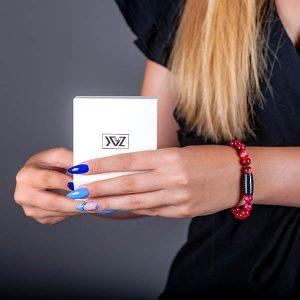 Girl hand with Carbon fiber Bracelet Tiger`s Eye Red